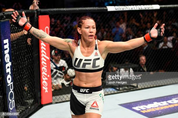 Cris Cyborg of Brazil celebrates after defeating Tonya Evinger in their UFC women's featherweight championship bout during the UFC 214 event inside...