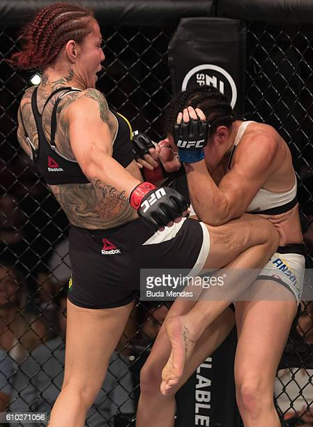 Cris Cyborg of Brazil kicks Lina Lansberg of Sweden in their catchweight bout during the UFC Fight Night event at Nilson Nelson gymnasium on...