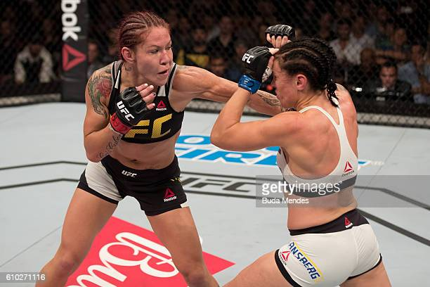 Cris Cyborg of Brazil punches Lina Lansberg of Sweden in their catchweight bout during the UFC Fight Night event at Nilson Nelson gymnasium on...