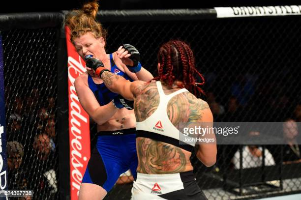 Cris Cyborg of Brazil punches Tonya Evinger in their UFC women's featherweight championship bout during the UFC 214 event at Honda Center on July 29...