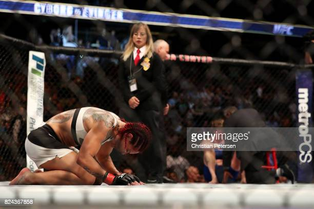 Cris Cyborg of Brazil reacts after defeating Tonya Evinger by TKO in their UFC women's featherweight championship bout during the UFC 214 event at...