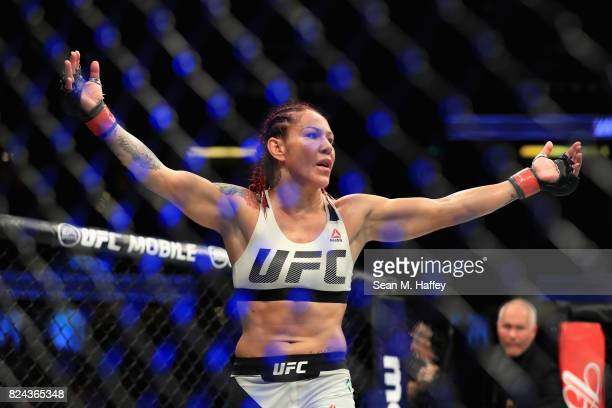Cris Cyborg of Brazil reacts to defeating Tonya Evinger during their Featherweight Title fight at UFC 214 at Honda Center on July 29 2017 in Anaheim...