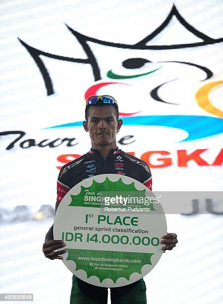 Cris Joven of Team 7 Eleven Roadbike Phillipine celebrates on the podium after winning the General Sprint Classification in the 2014 Tour de...
