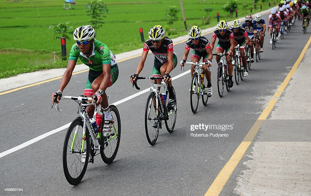 Cris Joven of Team 7 Eleven Roadbike Phillipine leads the peleton during stage 9 of the 2014 Tour de Singkarak from Pesisir Selatan to Padang City with a distance of 120.5 km on June 15, 2014 in Padang, Indonesia.
