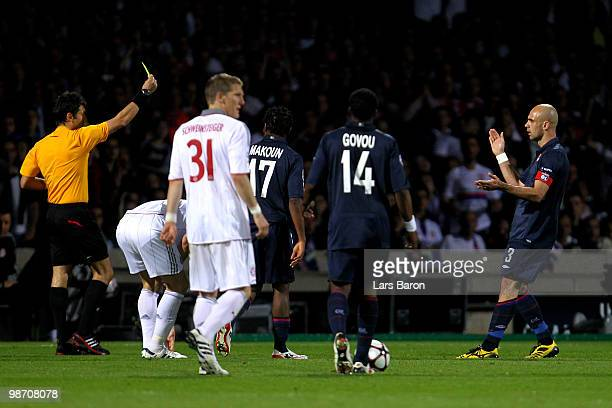 Cris of Olympique Lyonnais applauds the referee after he is sent off for receiving a second yellow card by Referee Massimo Busacca of Switzerland...