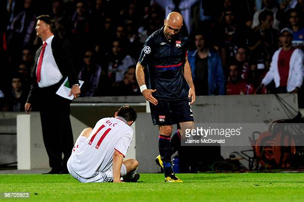 Cris of Olympique Lyonnais shouts at Ivica Olic of Bayern Muenchen after being sent off for receiving a second yellow card for fouling him during the...