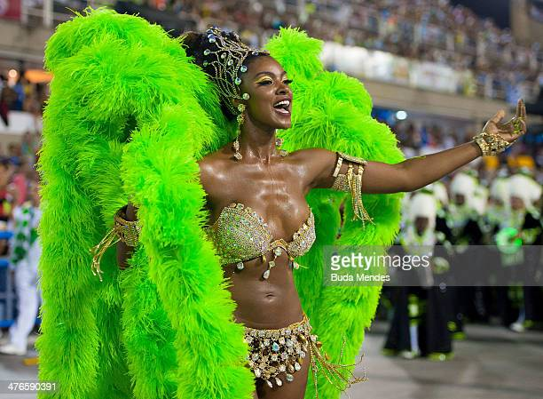 Cris Vianna Queen of Percussion of Imperatriz Leopoldinense samba school performs during its parade at 2014 Brazilian Carnival at Sapucai Sambadrome...