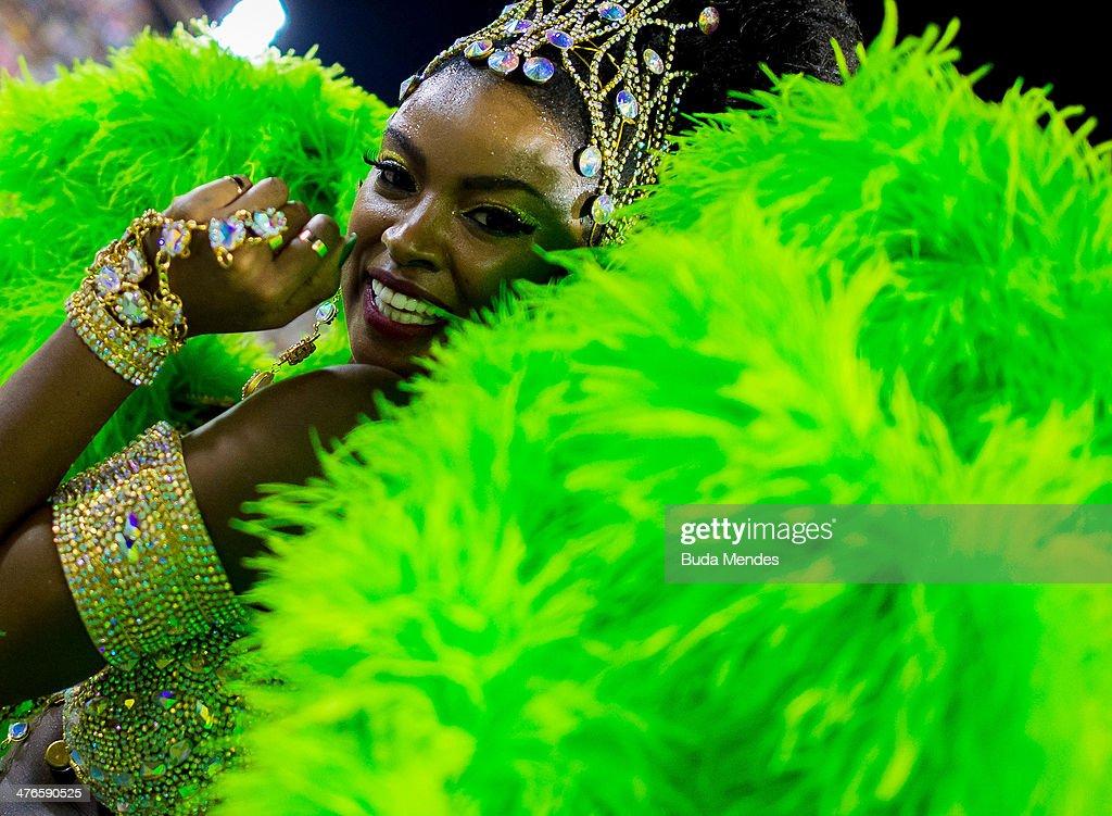 Cris Vianna Queen of Percussion of Imperatriz Leopoldinense samba school performs during its parade at 2014 Brazilian Carnival at Sapucai Sambadrome...