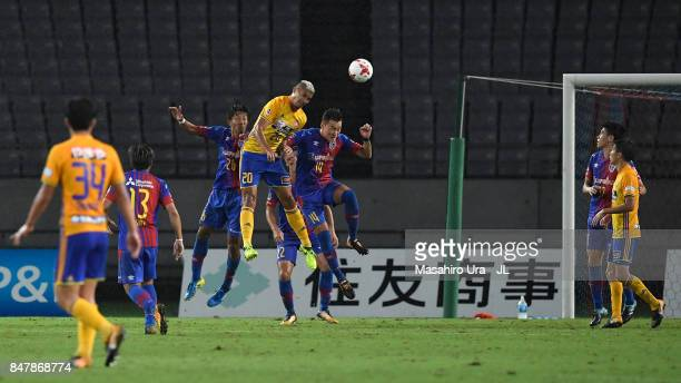 Crislan of Vegalta Sendai and Jang Hyun Soo of FC Tokyo compete for the ball during the JLeague J1 match between FC Tokyo and Vegalta Sendai at...