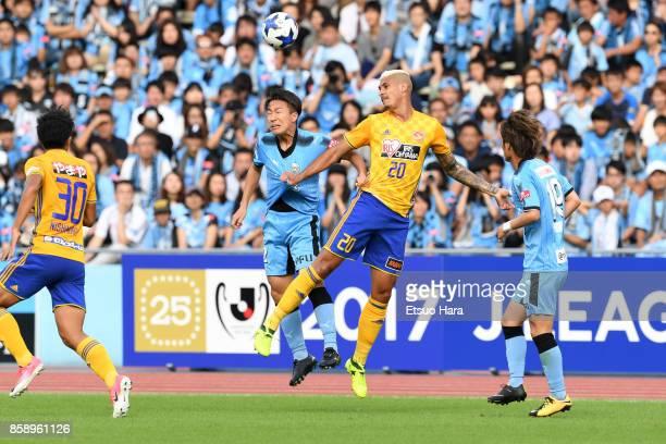 Crislan of Vegalta Sendai and Kyohei Noborizato of Kawasaki Frontale compete for the ball during the JLeague Levain Cup semi final second leg match...