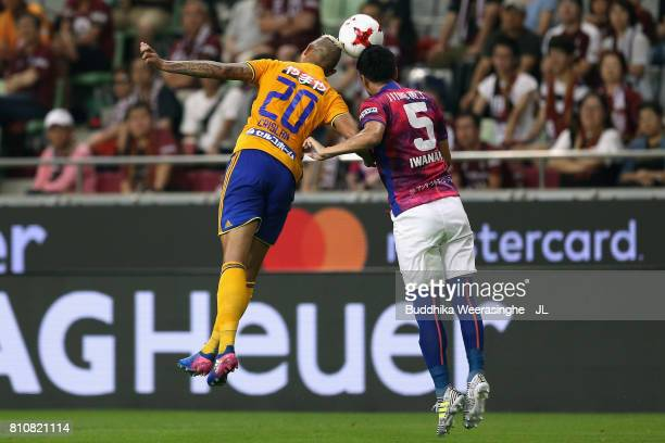 Crislan of Vegalta Sendai and Takuya Iwanami of Vissel Kobe compete for the ball during the JLeague J1 match between Vissel Kobe and Vegalta Sendai...