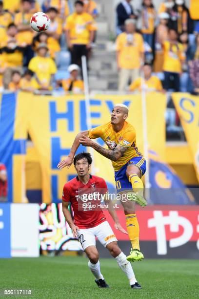 Crislan of Vegalta Sendai and Yuki Abe of Urawa Red Diamonds compete for the ball during the JLeague J1 match between Vegalta Sendai and Urawa Red...