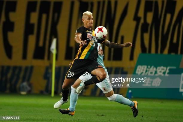 Crislan of Vegalta Sendai controls the ball under pressure of Shun Morishita of Jubilo Iwata during the JLeague J1 match between Vegalta Sendai and...