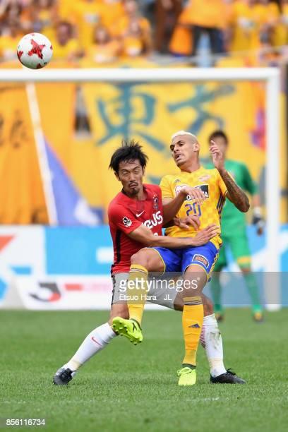 Crislan of Vegalta Sendai is challenged by Yuki Abe of Urawa Red Diamonds during the JLeague J1 match between Vegalta Sendai and Urawa Red Diamonds...