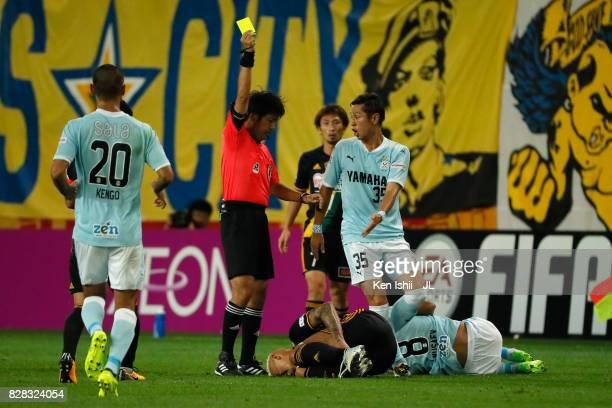 Crislan of Vegalta Sendai is shown a yellow card by referee Kenji Ogiya during the JLeague J1 match between Vegalta Sendai and Jubilo Iwata at Yurtec...