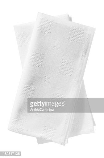 Crisp white linen serviettes on a white background