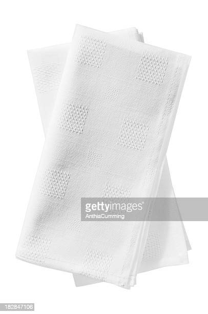 Crisp white linen serviettes on a white background
