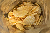 crisps potato chips in bag ready to eat - snack food background