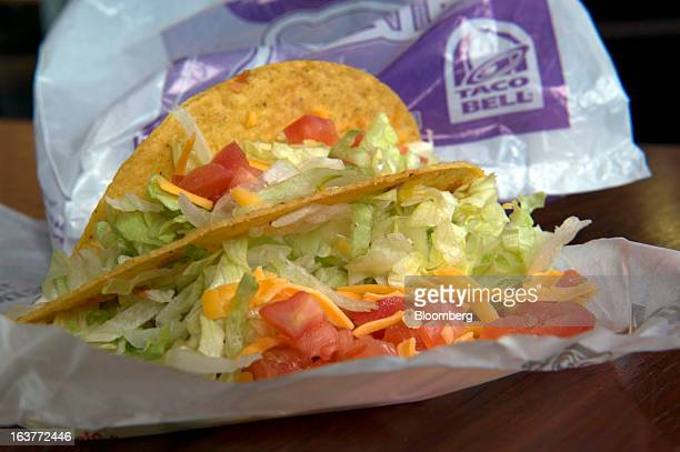 Crispy beef tacos from Taco Bell Corp are arranged for a photograph in San Francisco California US on Wednesday March 13 2013 Taco Bell sales began...