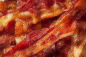 Crispy Organic Unhealthy Bacon on a Background