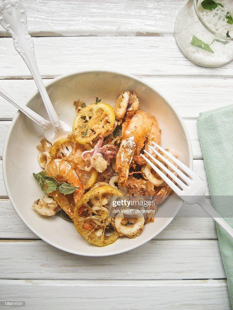 Crispy prawns and squid with kaffir lime sea salt : Stock Photo