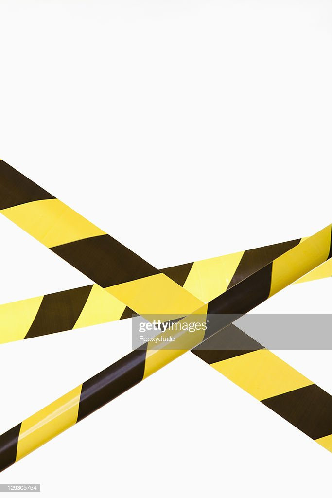 Crisscrossed yellow and black striped cordon tape