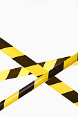 Crisscrossed yellow and black striped cordon tape