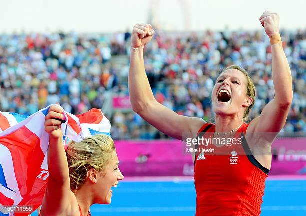 Crista Cullen of Great Britain celebrates with teammates their 31 victory over New Zealand during the Women's Hockey bronze medal match on Day 14 of...