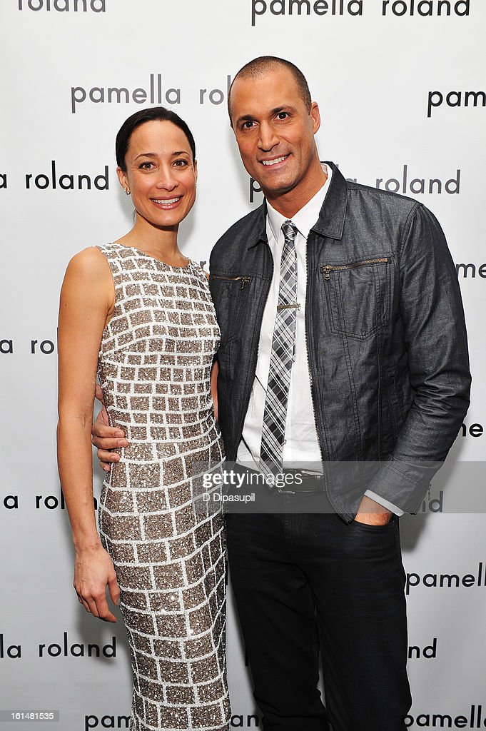 Cristen Barker and Photographer Nigel Barker pose backstage at the Pamella Roland Fall 2013 fashion show during Mercedes-Benz Fashion Week at at The Studio at Lincoln Center on February 11, 2013 in New York City.