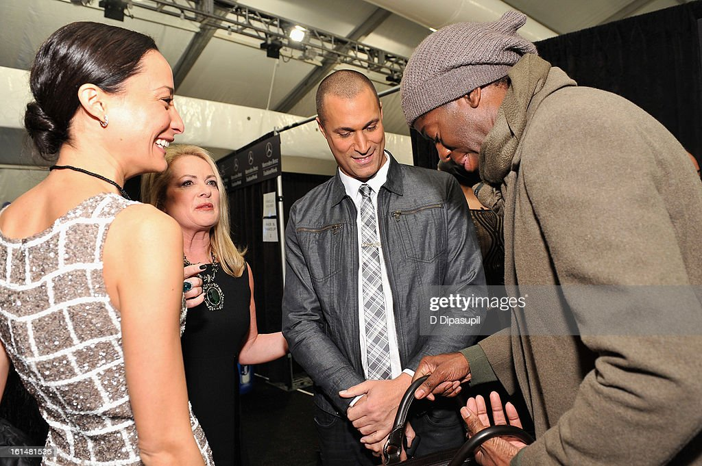 Cristen Barker, designer Pamella Roland, photographer Nigel Barker, and Miss J pose backstage at the Pamella Roland Fall 2013 fashion show during Mercedes-Benz Fashion Week at at The Studio at Lincoln Center on February 11, 2013 in New York City.