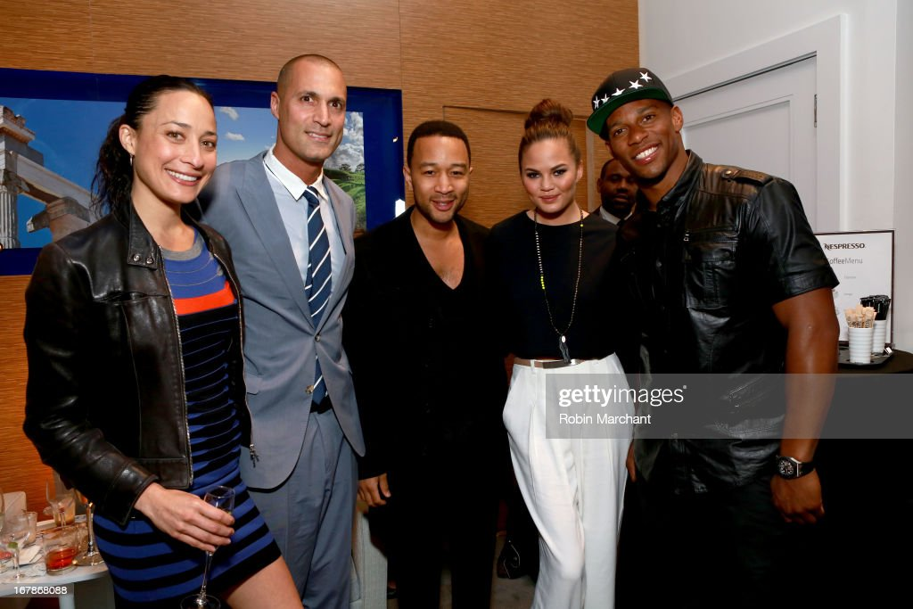 Cristen Barker, <a gi-track='captionPersonalityLinkClicked' href=/galleries/search?phrase=Nigel+Barker&family=editorial&specificpeople=691819 ng-click='$event.stopPropagation()'>Nigel Barker</a>, Chrissy Teigen <a gi-track='captionPersonalityLinkClicked' href=/galleries/search?phrase=John+Legend&family=editorial&specificpeople=201468 ng-click='$event.stopPropagation()'>John Legend</a>, and <a gi-track='captionPersonalityLinkClicked' href=/galleries/search?phrase=Victor+Cruz+-+American+Football+Player&family=editorial&specificpeople=8736842 ng-click='$event.stopPropagation()'>Victor Cruz</a> attend as Delta Air Lines celebrate the opening night of T4X, a pop up experience showcasing distinctive features of the airline's newly transformed international hub at JFK's Terminal 4 on May 1, 2013 in New York City.
