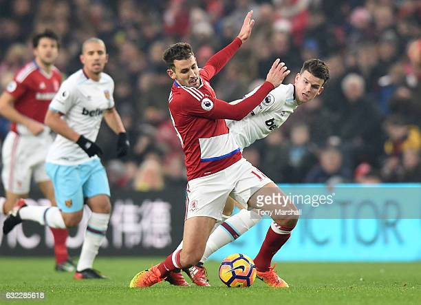 Cristhian Stuani of Middlesbrough and Sam Byram of West Ham United battle for possession during the Premier League match between Middlesbrough and...