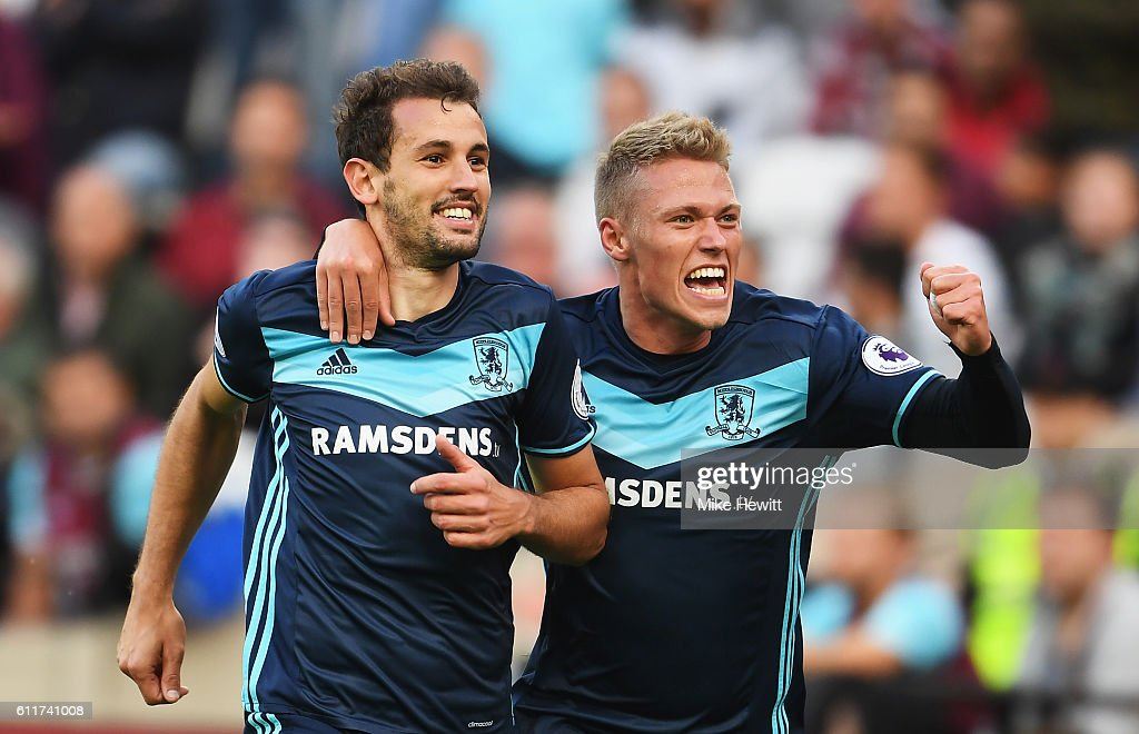 Cristhian Stuani of Middlesbrough celebrates scoring his sides first goal with Viktor Fischer of Middlesbrough (R) during the Premier League match between West Ham United and Middlesbrough at London Stadium on October 1, 2016 in London, England.