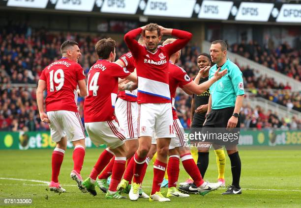 Cristhian Stuani of Middlesbrough reacts to giving away a penalty while his team mates plead with referee Kevin Friend during the Premier League...