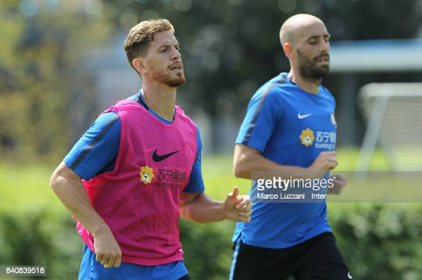 Cristian Ansaldi and Borja Valero of FC Internazionale run during the FC Internazionale training session at the club's training ground Suning...