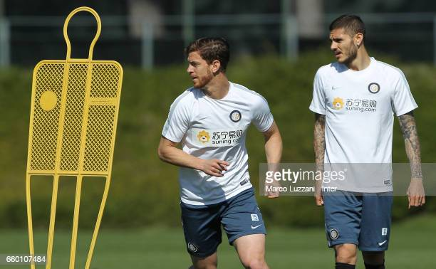 Cristian Ansaldi and Mauro Emanuel Icardi of FC Internazionale look on during the FC Internazionale training session at the club's training ground...