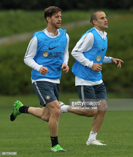 Cristian Ansaldi and Rodrigo Palacio of FC Internazionale Milano run during the FC Internazionale training session at the club's training ground...