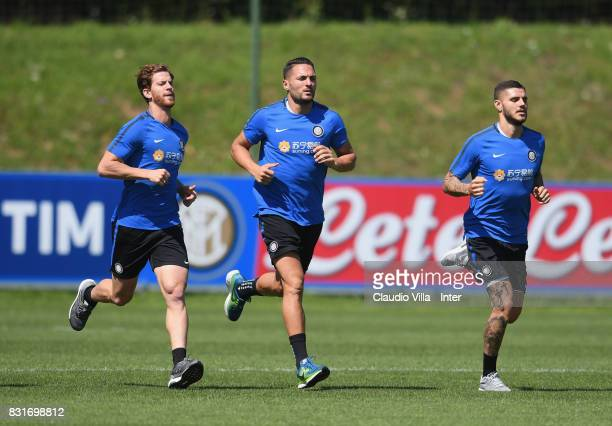 Cristian Ansaldi Danilo D'Ambrosio and Mauro Icardi of FC Internazionale in action during a training session at Suning Training Center at Appiano...