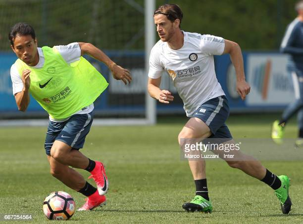 Cristian Ansaldi is challenged by Yuto Nagatomo during the FC Internazionale training session at the club's training ground 'La Pinetina' on April 11...