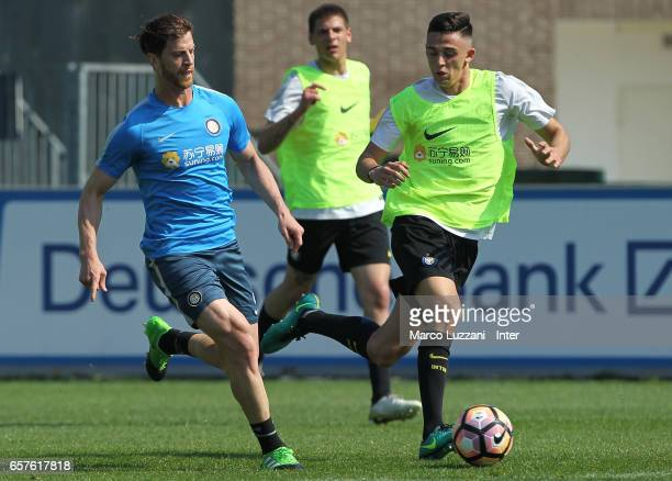 Cristian Ansaldi is challenged during the FC Internazionale training session at the club's training ground Suning Training Center in memory of Angelo...
