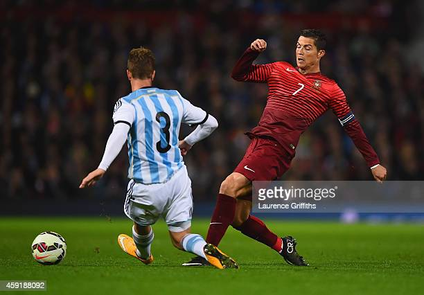 Cristian Ansaldi of Argentina challenges Cristiano Ronaldo of Portugal during the International Friendly between Argentina and Portugal at Old...