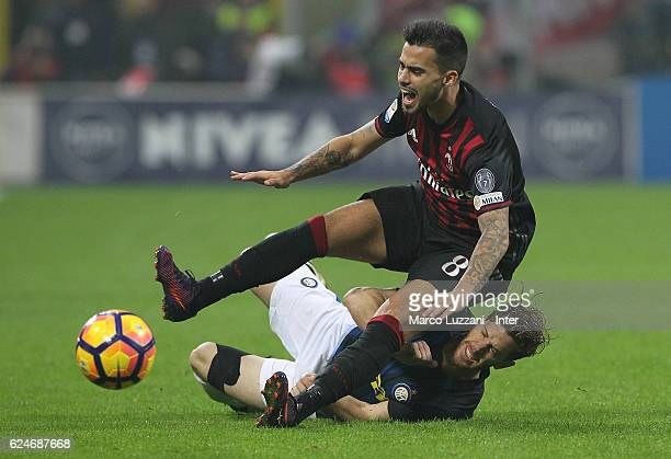 Cristian Ansaldi of FC Internazionale competes for the ball with Fernandez Suso of AC Milan during the Serie A match between AC Milan and FC...