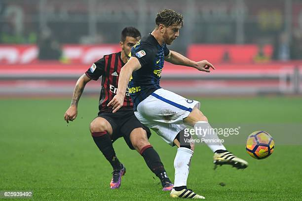 Cristian Ansaldi of FC Internazionale in action against Fernandez Suso of AC Milan during the Serie A match between AC Milan and FC Internazionale at...