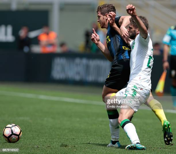 Cristian Ansaldi of FC Internazionale Milano competes for the ball with Domenico Berardi of US Sassuolo Calcio during the Serie A match between FC...