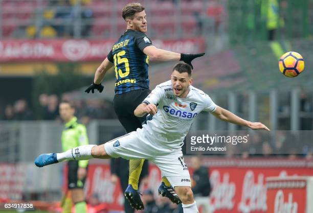 Cristian Ansaldi of FC Internazionale Milano jumps for the ball with Fredric Veseli of Empoli FC during the Serie A match between FC Internazionale...