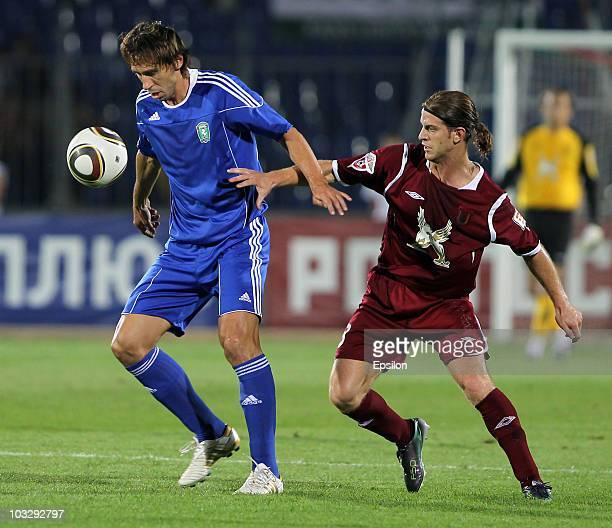 Cristian Ansaldi of FC Rubin Kazan battles for the ball with Aryom Dzuba of FC Tom Tomsk during the Russian Football League Championship match...