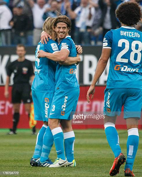 Cristian Ansaldi of FC Zenit St Petersburg celebrates his goal with teammates during the Russian Premier League match between FC Zenit St Petersburg...