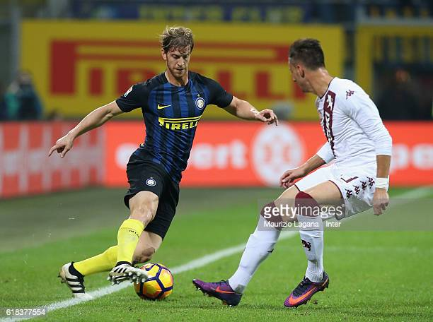 Cristian Ansaldi of Inter competes for the ball with Antonio Barreca of Torino during the Serie A match between FC Internazionale and FC Torino at...