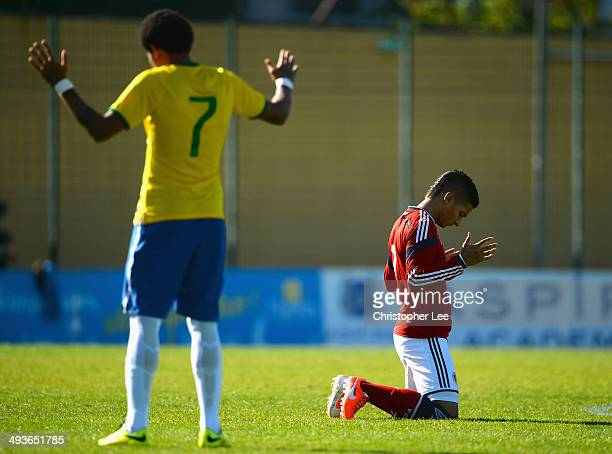 Cristian Arango of Colombia and Leandro of Brazil pray before kick off during the Toulon Tournament Group B match between Brazil and Colombia at the...