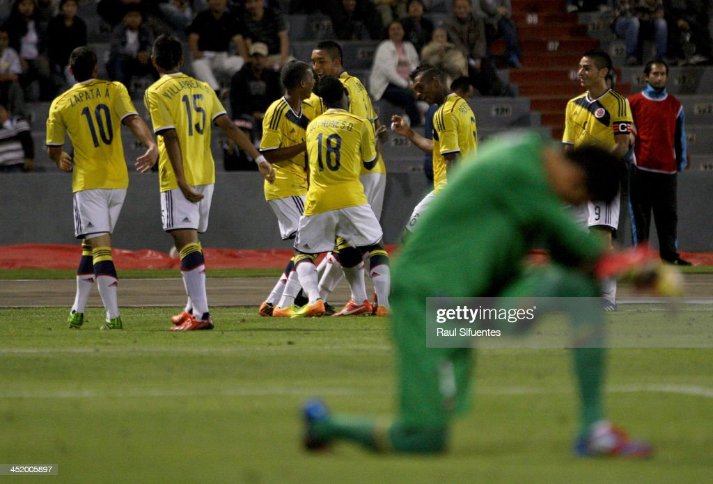 Cristian Arango of Colombia celebrates with his teammates a scored goal against Ecuador during the football final match between Colombia and Ecuador as part of the XVII Bolivarian Games Trujillo 2013 at Mansiche Stadium on November 25, 2013 in Trujillo, Peru.